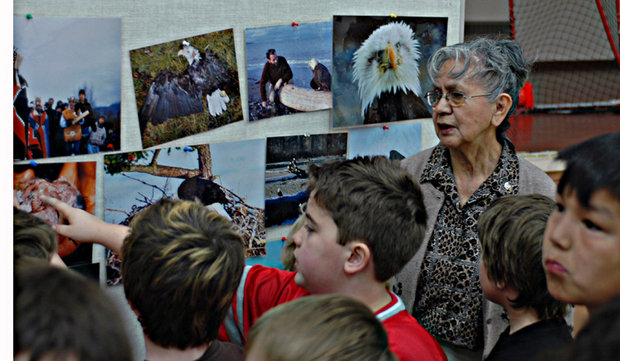 Grand Chief Dr Rose reviewing some of the images with children after the talk.