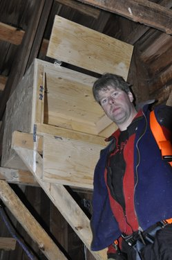 Chris with the box - showing double doors - to slow down escape at banding time