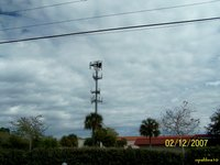 West view of the cell tower from the 4 lane road, located in Coquina Plaza. Coquina Bay is just a few hundred feet to the east-back of pic, where the Eagles shop for there meals! :)